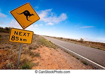 Outback Kangaroo Sign - Kangaroo warning sign on a road in...