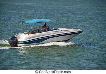 Outboard Motorboat - blue and white outboard motorboat with...