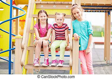 Outdoor activity - Active girls having fun on playground