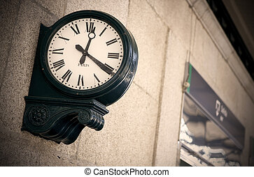 Railway station outdoor analog clock with roman numbers