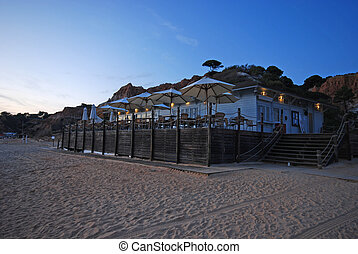beach cafe on tourist resort terrace - Outdoor beach cafe on...