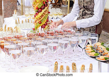 Outdoor Beautifully decorated catering banquet table with different food snacks and appetizers on corporate party event or wedding celebration. Service concept. Selective focus. Close up