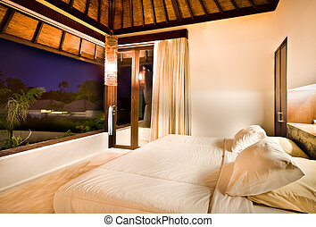 Outdoor bedroom at night with lights on