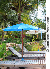 outdoor blue and white umbrella near pool  in Thailand