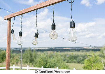 outdoor cafe decorations with lights and garlands