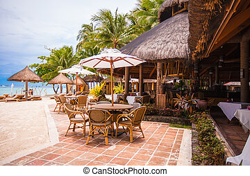 Outdoor cafe on tropical beach