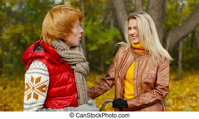 Lovely young couple conversing outdoors in the autumn park