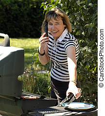 Outdoor Cooking - Attractive Woman Cooking On A BBQ