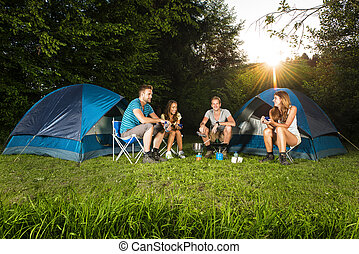 Outdoor cooking - cooking on a camping with a group of young...