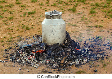 outdoor cooking in mongolia - outdoor cooking in a milk...