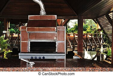 Outdoor cooking stove and fireplace in a resort hotel