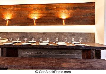 Outdoor dining area illuminated with orange lights