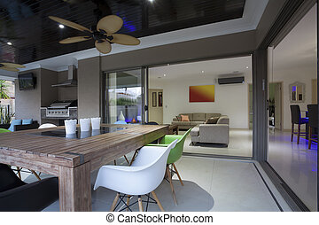 Outdoor entertaining area - Stylish open home interior with...