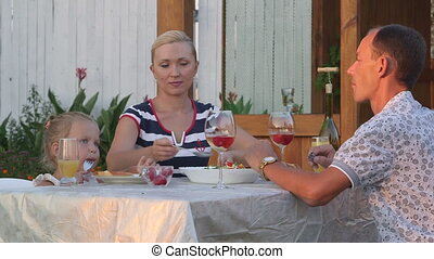 Outdoor family dinner in backyard area