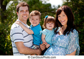 Outdoor Family Portrait - Outdoor portrait of a happy young...