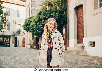 Outdoor fashion portrait of 8-9 year old hipster girl...