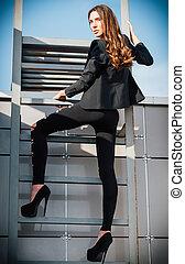 Outdoor fashion shot: sexy beautiful young woman in pants,...