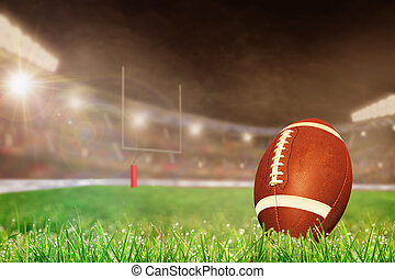 Outdoor Football Stadium With Ball on Grass and Copy Space