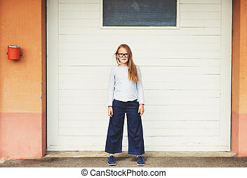 Outdoor funny portrait of a cute little 9-10 year old girl...