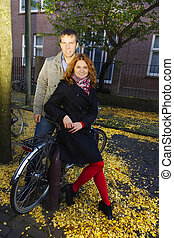 Outdoor happy couple in love, autumn Amsterdam background