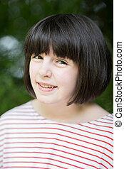 Outdoor Head And Shoulder Portrait Of Smiling Pre Teen Girl