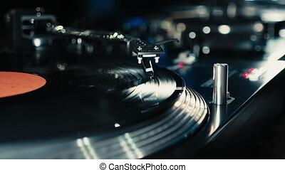Dj playing on vinyl. Turntable close up.