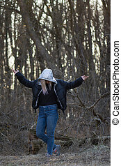 Outdoor nature relax concept. Carefree and happy woman with open arms.