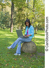 Outdoor online purchase - Young woman buying online...