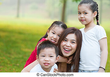 Asian mother and children