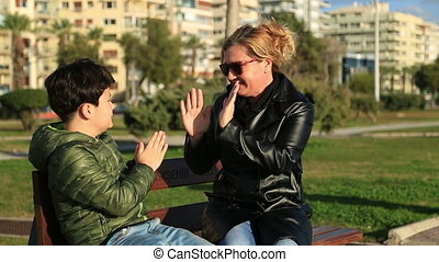 Outdoor park happy mother and son