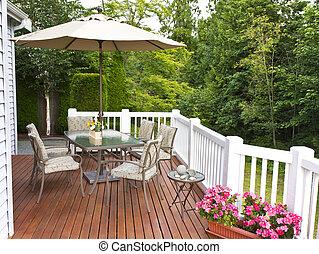 Outdoor Patio - Outdoor patio setup on cedar wood deck with...