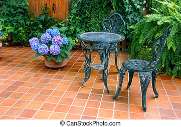 Outdoor Patio Set on a tile floor with plants