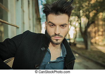 young fashion man posing on the street