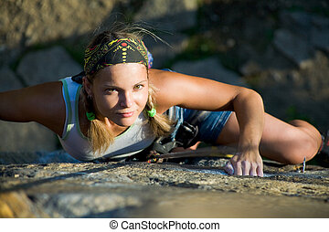 Outdoor - Image of blonde lady climbing on the rock