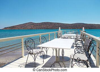 Outdoor pier cafe. Elounda, Crete