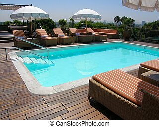 outdoor pool - an in-ground outdoor pool on a roof top