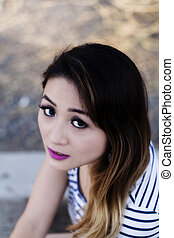 Outdoor Portrait Asian American Woman Looking Up