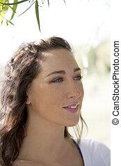 Outdoor portrait attractive brunette caucasian woman