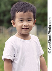 outdoor portrait head shot of asian children smiling face looking with eyes contact to camera