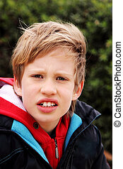 Outdoor portrait of 7 years old boy