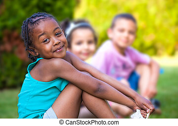 Outdoor portrait of a Adorable little African American girl
