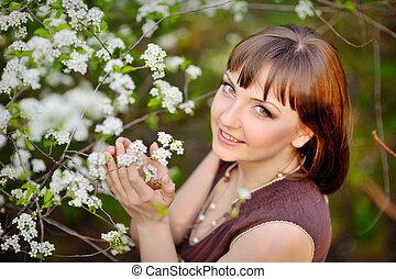 outdoor portrait of a beautiful brunette woman in blue dress amo