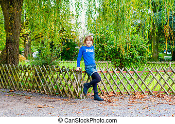 Outdoor portrait of a beautiful little girl in a park