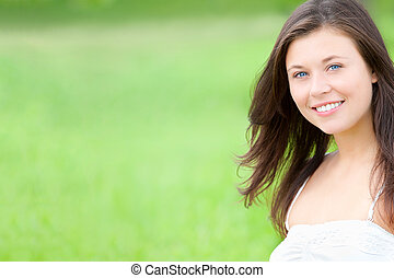 Outdoor portrait of a beautiful young woman, closeup