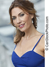 Outdoor Portrait of A Beautiful Young Woman In Her Thirties...