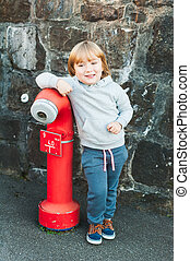 Outdoor portrait of a cute little boy