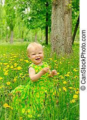 Outdoor portrait of a cute little girl