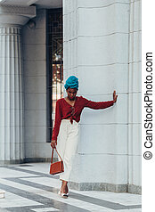Outdoor portrait of a fashionable muslim african woman