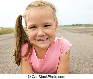 Outdoor portrait of a little girl