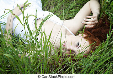 Outdoor portrait of a red hair woman, fashion white dress